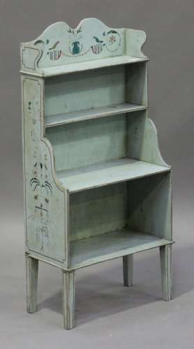 An early 20th century Swedish painted open bookcase, the shaped gallery decorated with birds and
