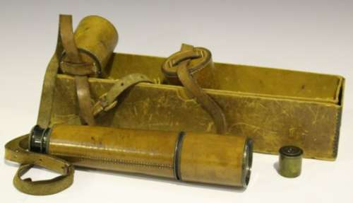 An early 20th century leather bound brass four-draw telescope, unsigned, unextended length 27.8cm,