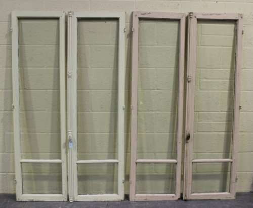 Two early 20th century matching pairs of white painted French doors, each pair with a locking handle