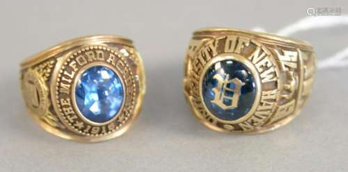 Two 10K gold class rings, 38.8 grams total weight.