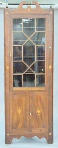 Custom mahogany inlaid corner cabinet having roken arch