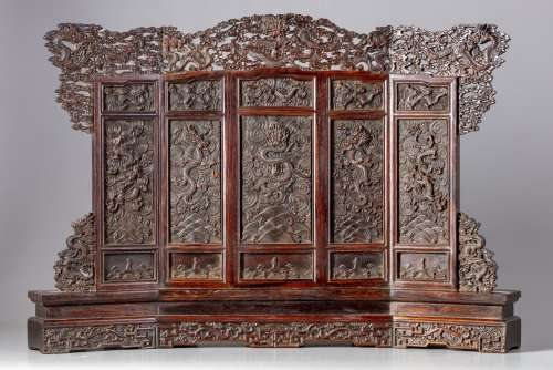 A Chinese hardwood carved 'dragons' table screen