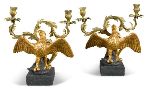 A PAIR OF HERALDIC TERRACOTTA CRESTS ADAPTED AS CANDELABRA, 20TH CENTURY, IN THE FORM OF AN EAGLE IMPALING A SERPANT, WITH GILT-BRASS TWIN-BRANCH CANDLEARMS