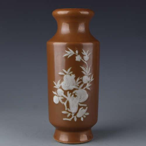 A Kangxi purple-gold glazed vase with white flower