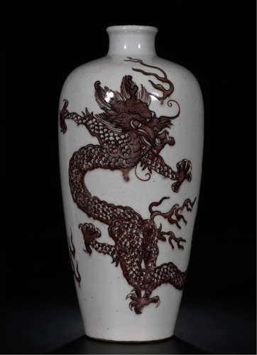 A CHINESE PORCELAIN RED GALZED DRAGON VASE
