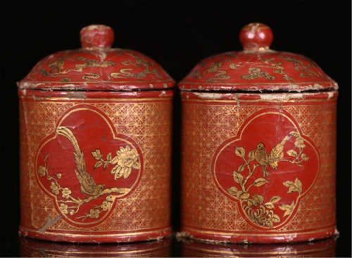 A PAIR OF CHINESE GOLD PAINTED LACQUER BIRD LIDDED POTS