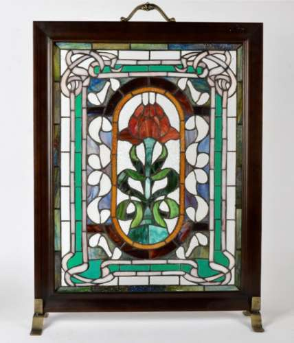 A stained glass fire screen, with central motif of a red rose, height 76cm
