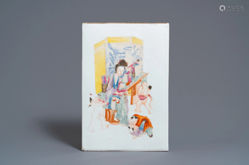A Chinese famille rose plaque with a lady with play…
