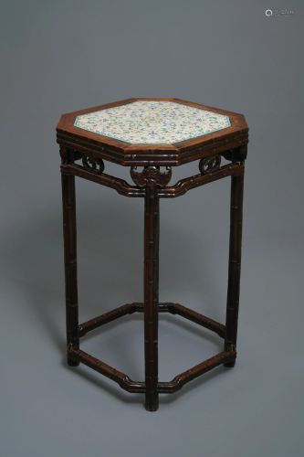 A Chinese huali wooden stand with famille r…