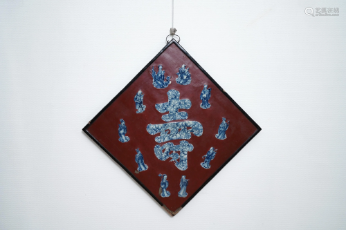 A Chinese red-lacquered plaque with blue a…