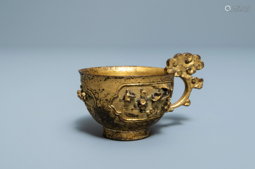 A Chinese relief-decorated gilt bronze cup, M…