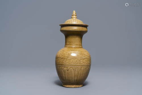 A Chinese brown-glazed vase and cover with incised