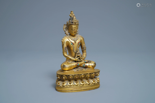 A Chinese coral- and turquoise-inlaid gilt bronze