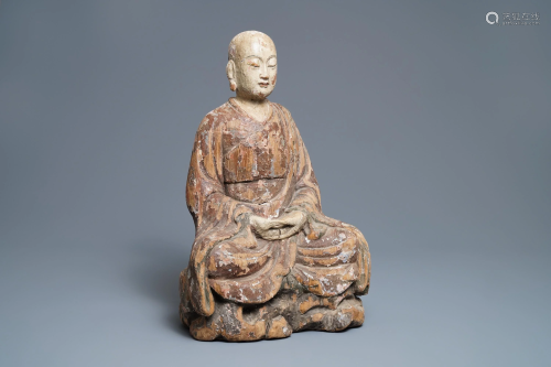 A large Chinese painted wood figure of a Buddhist m…
