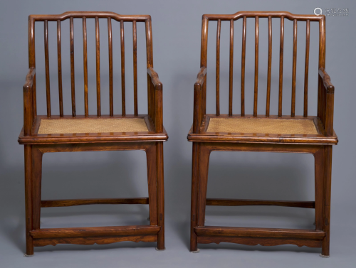 A pair of Chinese huanghuali wood chairs, Rep…