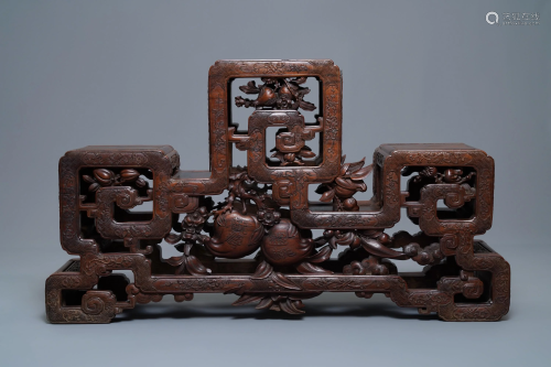 A Chinese finely carved wooden display stand, 19th C.