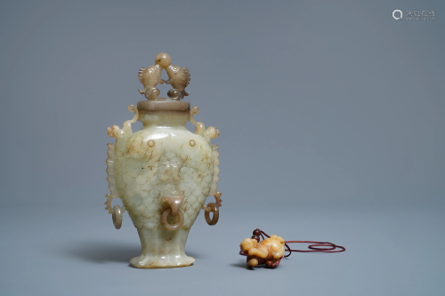 A Chinese jade 'twin fish' vase and a russet jade …