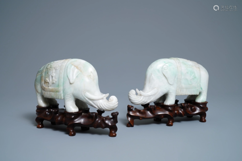 A pair of Chinese jadeite models of elephants, …