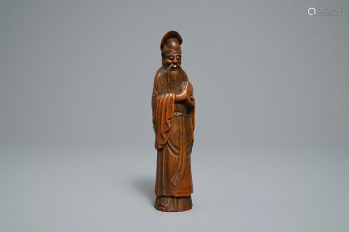 A Chinese carved bamboo figure of Shoulao,