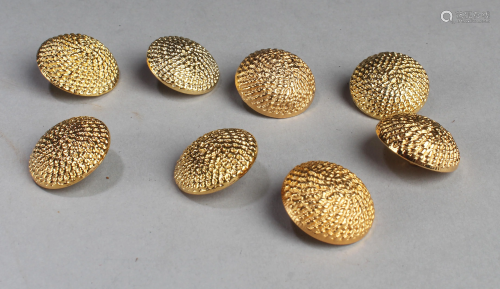 A Group of Eight Buttons