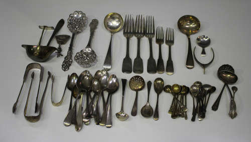 A group of mostly silver cutlery, including a George III Old English pattern caddy spoon, London