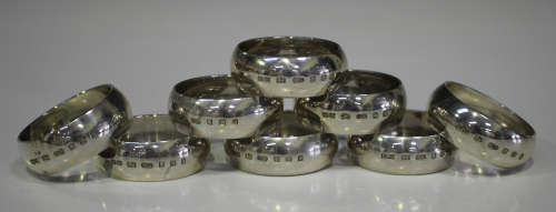 A set of eight Elizabeth II silver plain circular napkin rings, London 2002 by Whitehill Silver &