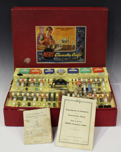 A Merit chemistry set, boxed (contents unchecked, box creased, torn and scuffed).Buyer's Premium