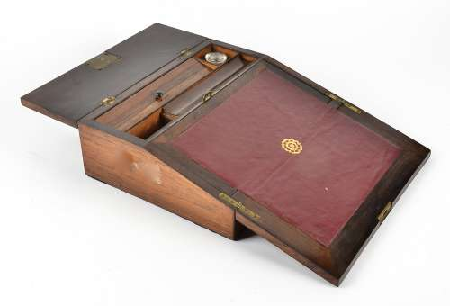 A Victorian rosewood writing slope, with mother of pearl inlays, fitted interior containing one