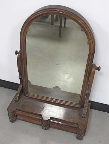A William IV mahogany dressing table mirror, the arched swing mirror above a two drawer base, raised