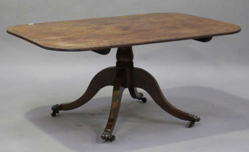 A Regency mahogany tip-top breakfast table with ebony stringing, raised on a turned column and sabre