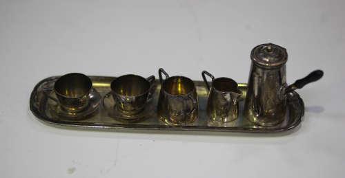 An Edwardian silver toy six-piece hot chocolate set, comprising chocolate pot, twin-handled sugar