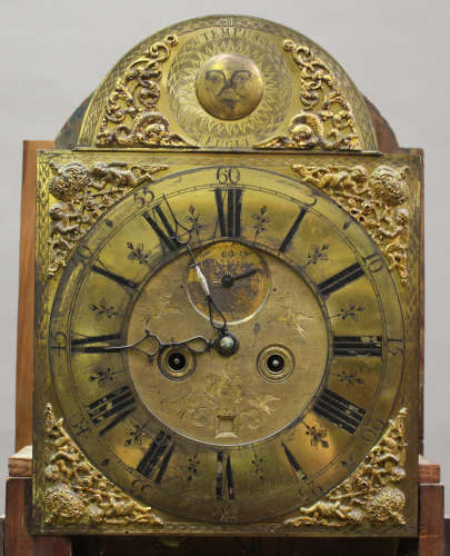 A mid-18th century mahogany longcase clock with eight day movement striking on a bell, the brass