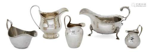 An assortment of five silver cream jugs, various dates and makers, including one raised on a