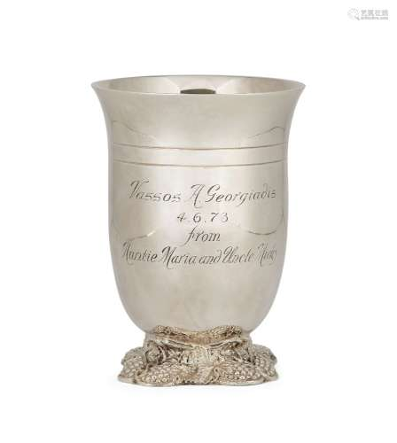 A silver wine beaker, London, c.1971, Garrard & Co., raised on a quatrefoil foot decorated with
