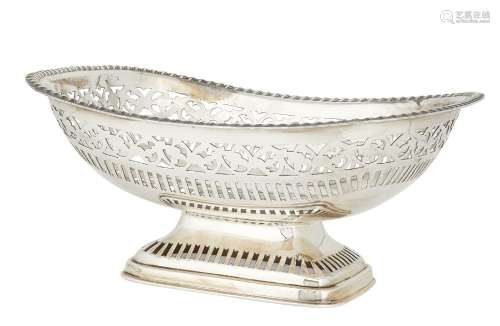 A large silver dish with pierced border, Sheffield, c.1928, James Deakin & Sons., raised on a