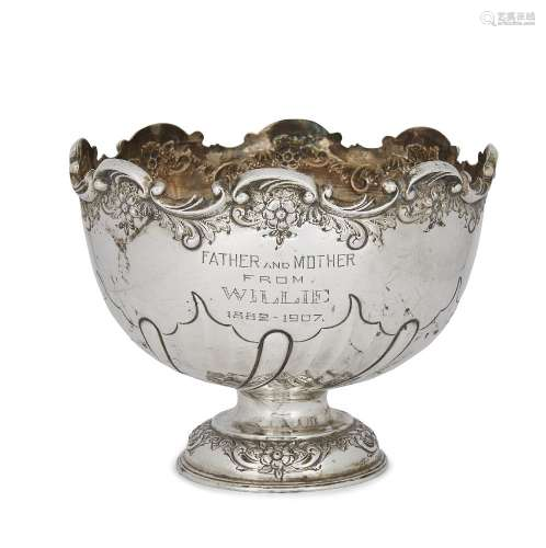 A silver presentation bowl, Sheffield, c.1905, Levesley Brothers, the half-lobed twist repousse bowl