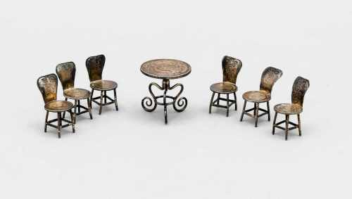 Seven-piece miniature seating group, 20th century, silver tested, table with 6 chairs,