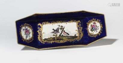 Sèvres (kind of) Ravier in the shape of a boat in soft porcelain with polychrome decoration of birds on a terrace and bouquets of flowers on a blue background.  Apocryphal mark of Sèvres.  19th century.  L. 27 cm.