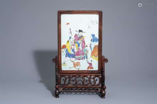 A Chinese wooden table screen with a famille rose ...