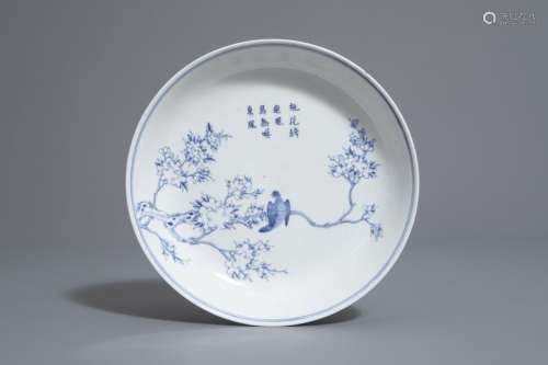 A Chinese blue and white plate with a bird on a br...