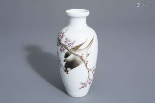 A Chinese famille rose vase with a bird among a fl...