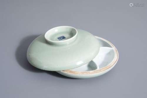 A Chinese celadon spice box, Qianlong mark, 19th C...