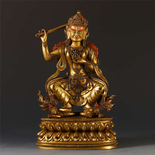 CHINESE GILT BROZNE CARVED GUANYIN ON LOTUS