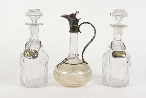 A pair of 20th Century glass decanters, moulded glass with stoppers, with 'Whiskey' and 'Claret'