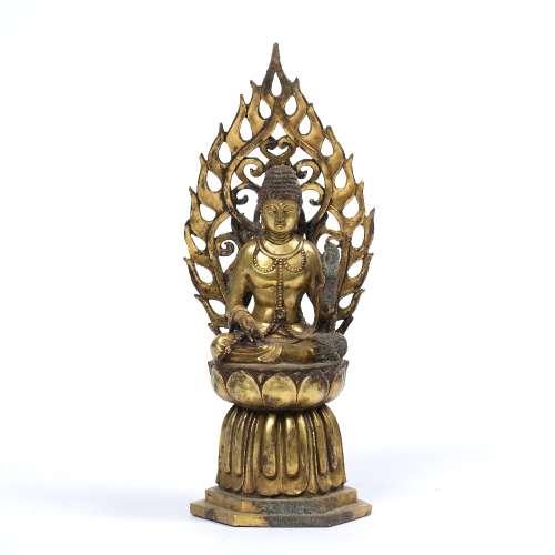 Gilt bronze figure of Avolokitesvara Sino-Tibetan/Korean depicted sitting cross legged with a hand