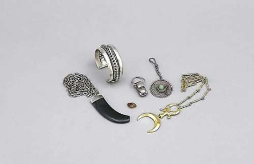 Compilation of costume jewelery, 20th cent., partly silver, partly with stones, bangle,chains with
