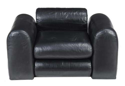 A black leather upholstered lounge armchair