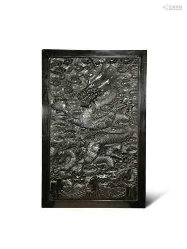 A CHINESE HARDWOOD RECTANGULAR 'DRAGON' PANEL 19TH CENTURY One side carved in relief with a dragon