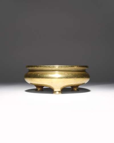 A CHINESE GILT-BRONZE TRIPOD INCENSE BURNER QING DYNASTY The compressed body surmounted by a short