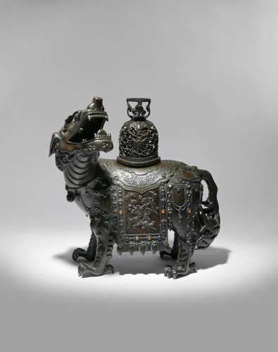 A LARGE CHINESE BRONZE 'MYTHICAL BEAST' INCENSE BURNER AND COVER QING DYNASTY Cast as a lion-like